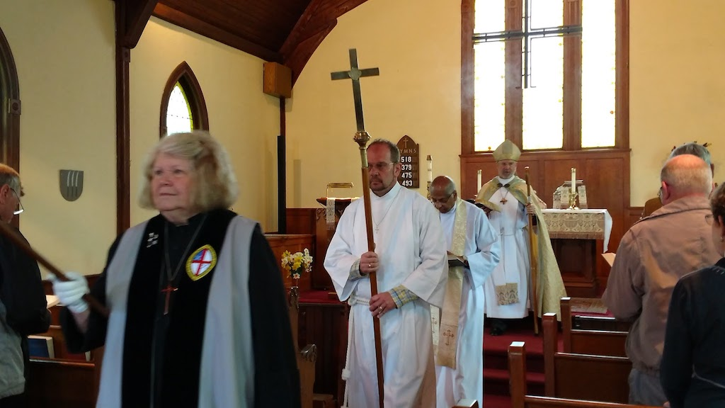 Bishop Ian Douglas during the Gospel Procession during worship at St. Paul's Episcopal Church in Westbrook, CT