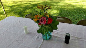 Flower arrangements on a table at the Ham and Beans Supper hosted by St. Paul's Episcopal Church in Westbrook, CT